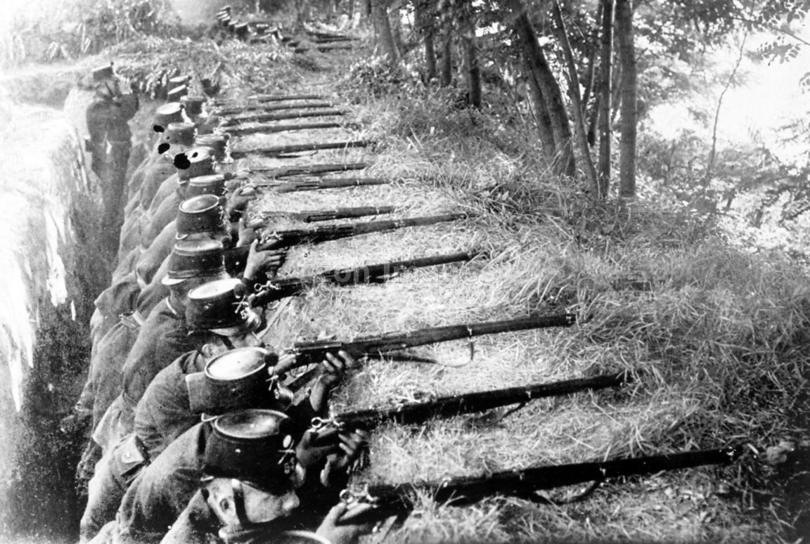 Swiss soldiers fire from trench during WWI